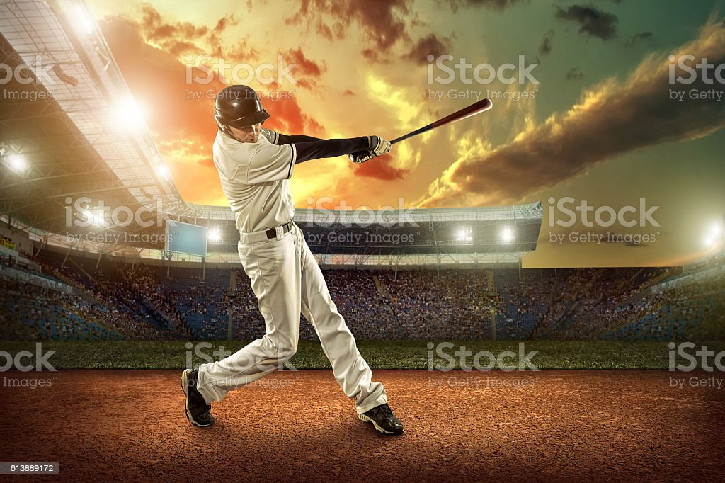 Baseball players in action on the stadium. stock photo
