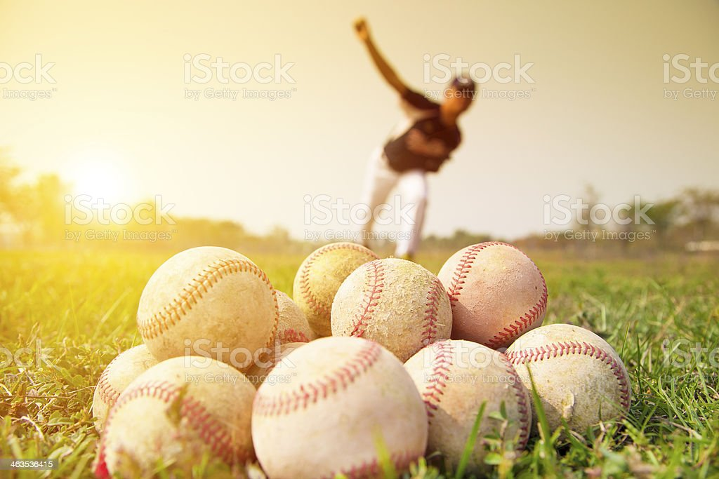 Baseball players to practice pitching outside stock photo