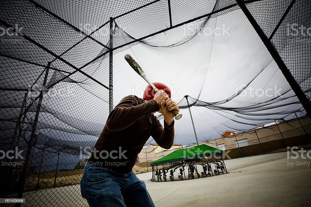 Baseball Practice: Man at Batting Cages stock photo