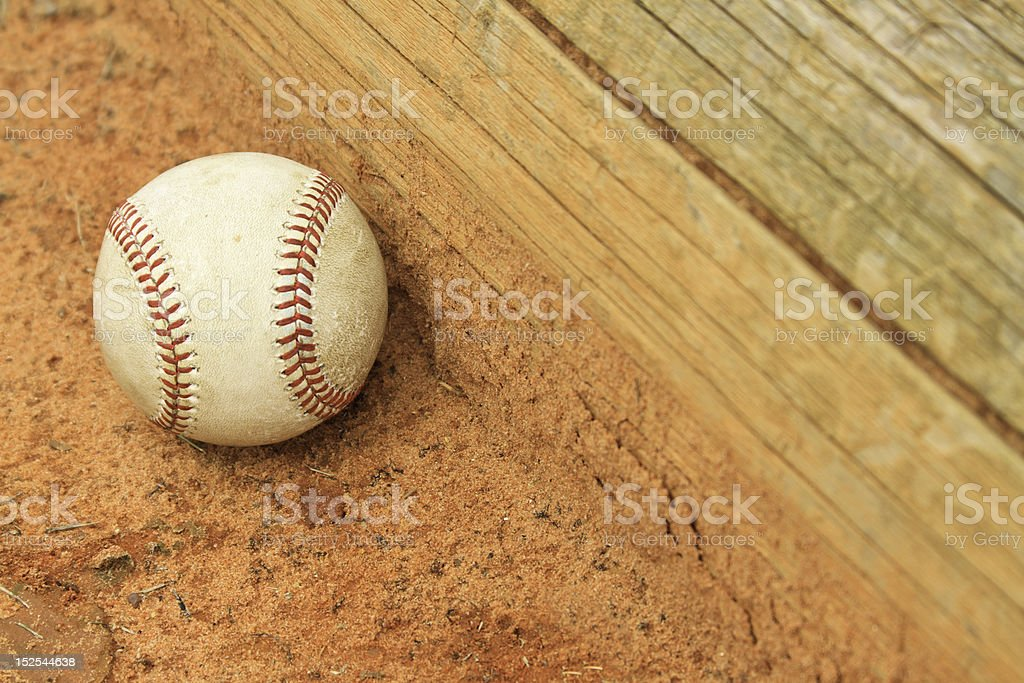 Baseball Resting Against Dugout Steps royalty-free stock photo