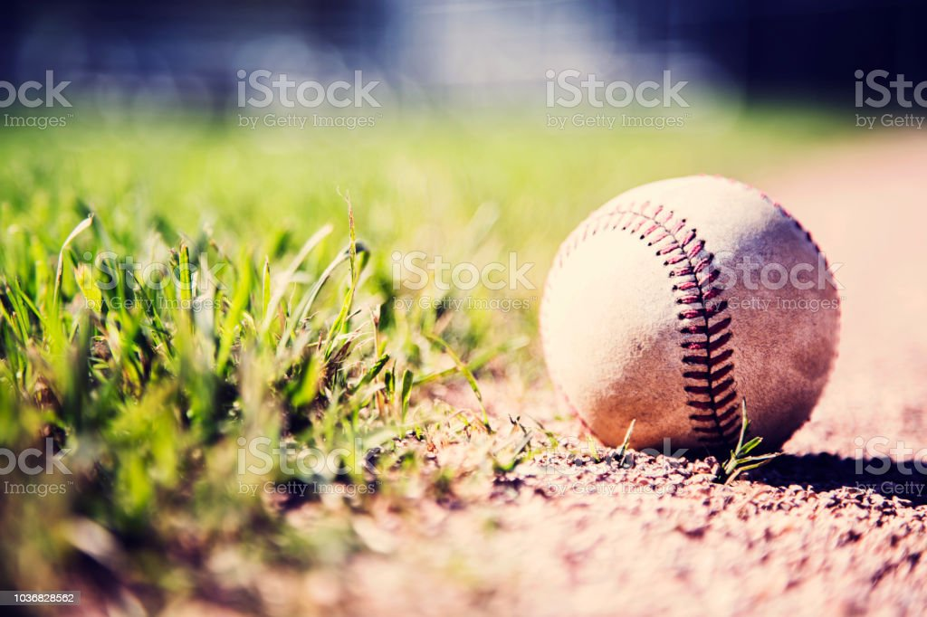 Baseball season is here.  Weathered ball on field. royalty-free stock photo