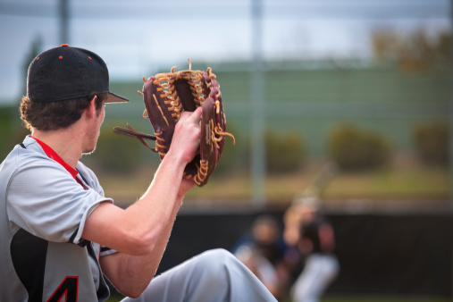 Baseball Series: Pitcher in motion, batter, catcher and umpire defocused