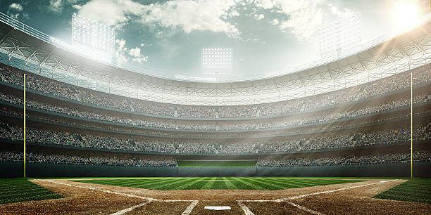Baseball stadium A wide angle of a outdoor baseball stadium full of spectators under a cloudy sky at midday. The image has depth of field with the focus on the foreground part of the pitch. baseball sport stock pictures, royalty-free photos & images