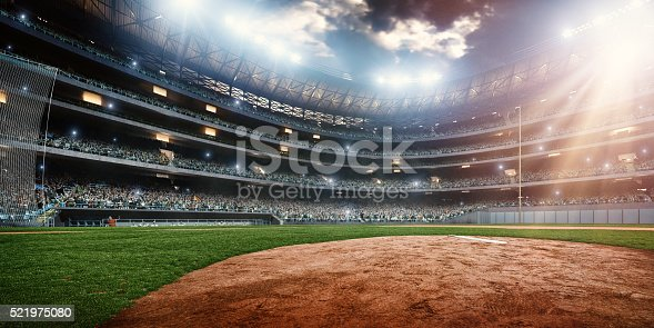 A wide angle of a outdoor baseball stadium full of spectators under a stormy night sky. The image has depth of field with the focus on the foreground part of the pitch. Stadium and all elements are made in 3D.