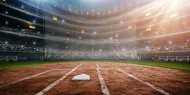 Baseball stadium A wide angle of a outdoor baseball stadium full of spectators under a stormy night sky. The image has depth of field with the focus on the foreground part of the pitch. Stadium and all elements are made in 3D.  baseball diamond stock pictures, royalty-free photos & images