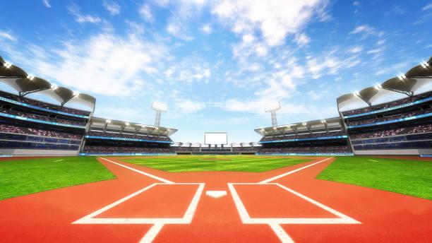 baseball stadium playground with blue cloudy sky stock photo