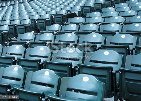 Closeup of empty seats at a baseball stadium.