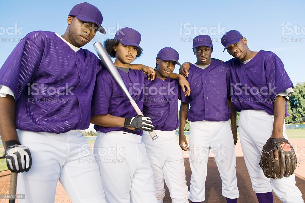 Baseball Teammates Posing Before Game stock photo