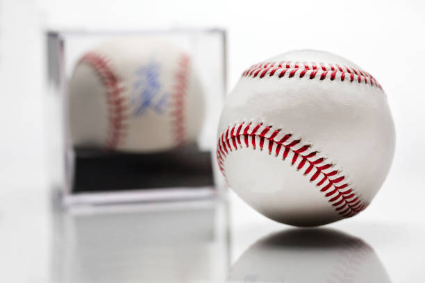 Baseball With Display Case Autographed Memorabilia Blurred In Background Isolated On White Baseball With Display Case Autographed Memorabilia Blurred In Background Isolated On White signature collection stock pictures, royalty-free photos & images