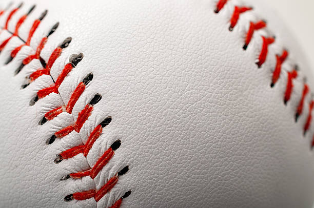 Baseball with the focus on the stitches with copyspace stock photo