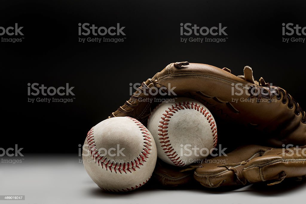 Baseballs and glove on clean background stock photo