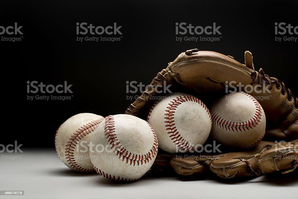 Baseballs and glove stock photo
