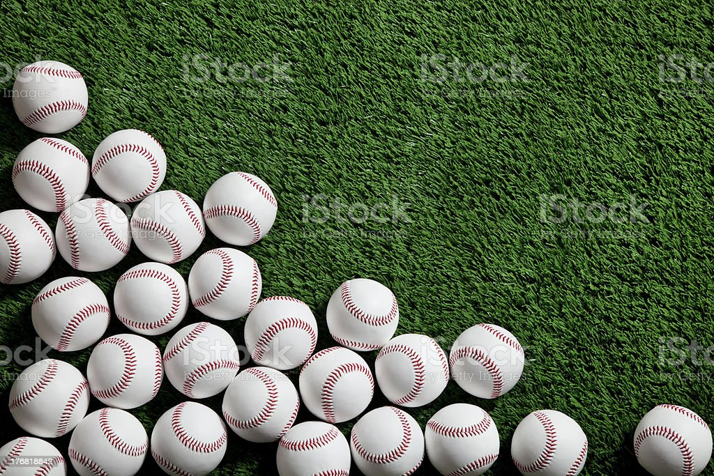 Baseballs on grass field shot from above royalty-free stock photo