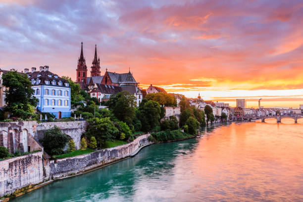 Basel, Switzerland. Basel, Switzerland.  Old town with Munster cathedral on the Rhine river at sunset. switzerland stock pictures, royalty-free photos & images