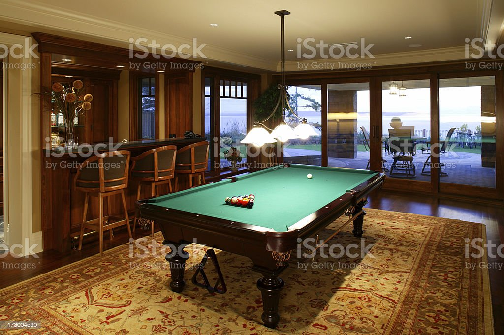 basement games room pool table stock photo