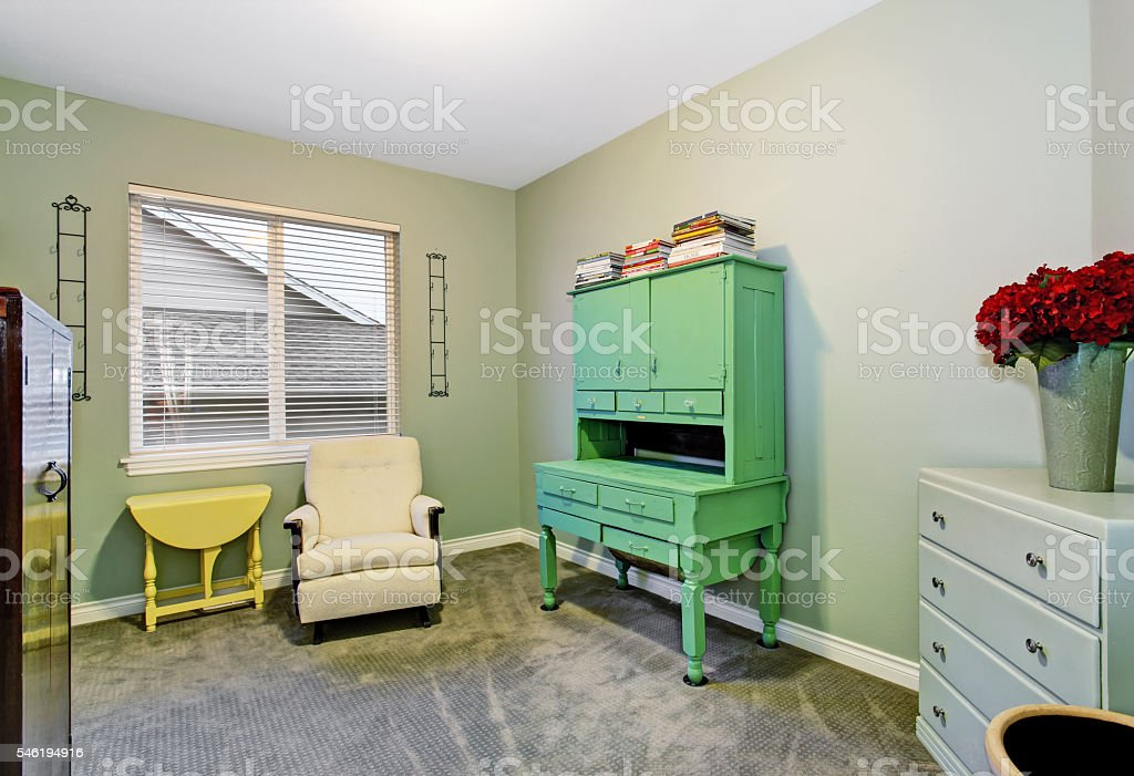 Basement Room Interior With Comfortable Armchair And Old Furniture
