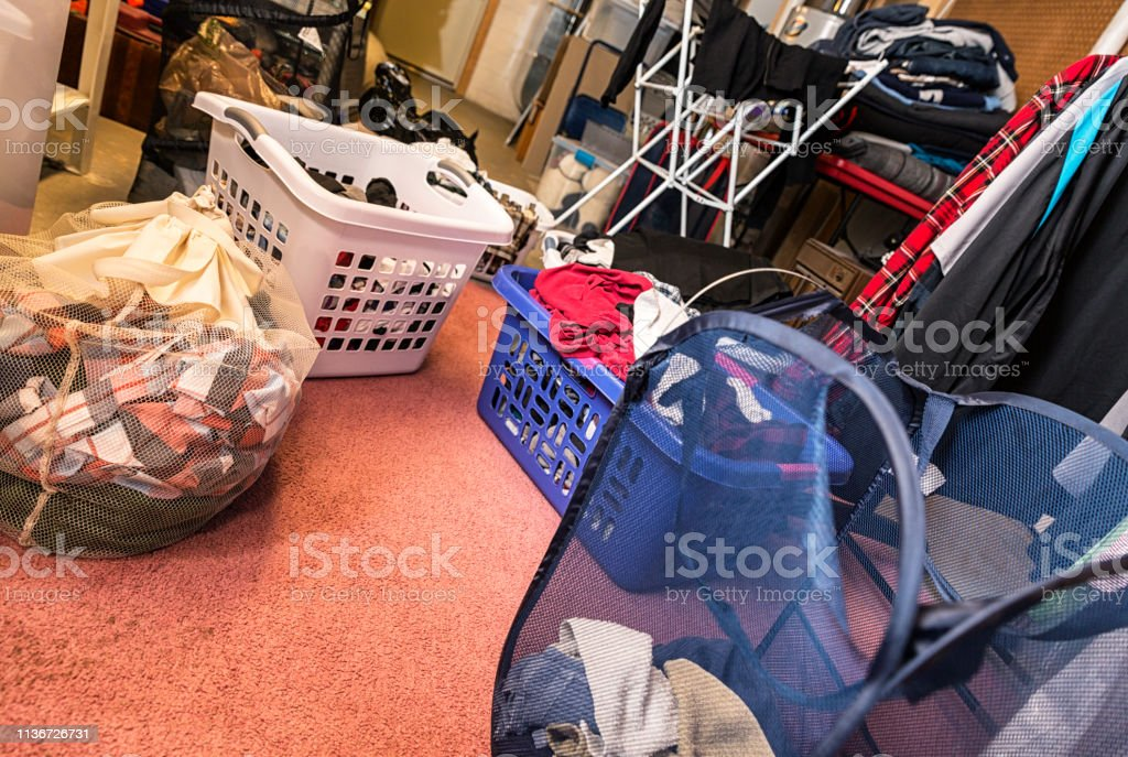 An authentic real life home basement utility room overflowing on...