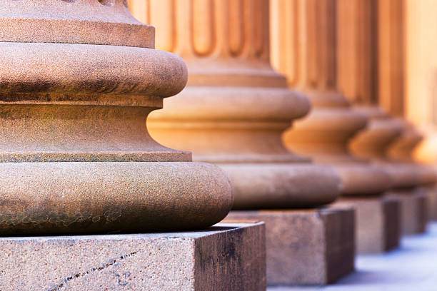 bases of marble row columns - stability stock photos and pictures