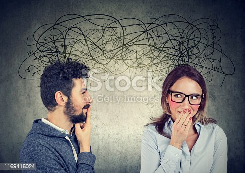 istock bashful woman looking at a handsome man both exchanging with each other with many thoughts 1169416024
