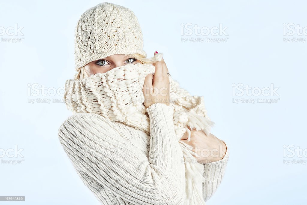 Bashful Young Blonde Woman in White Sweater stock photo