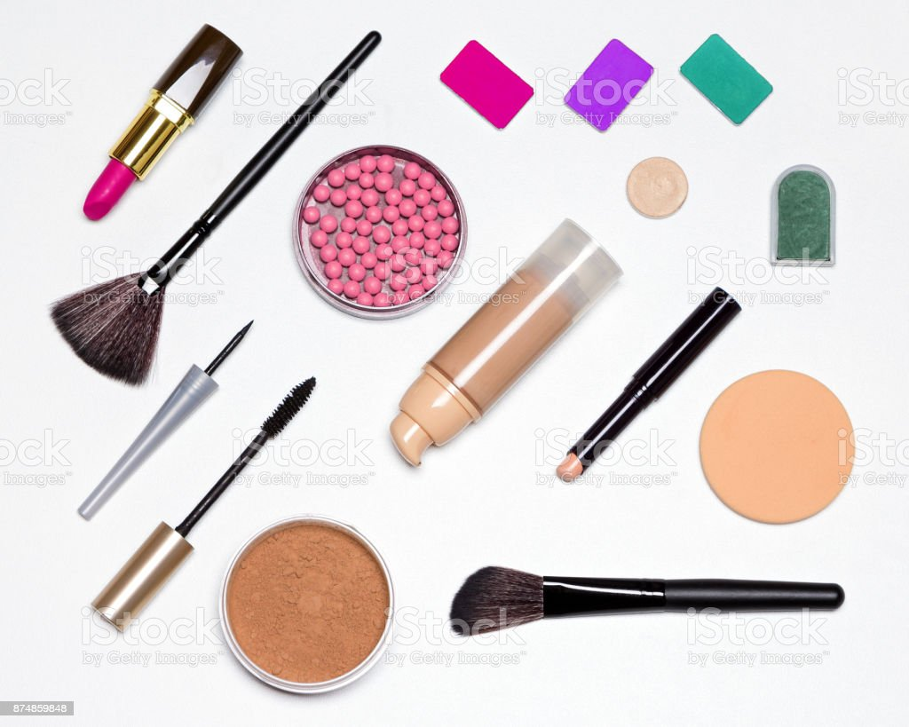 Basic contents of cosmetic bag flat lay stock photo