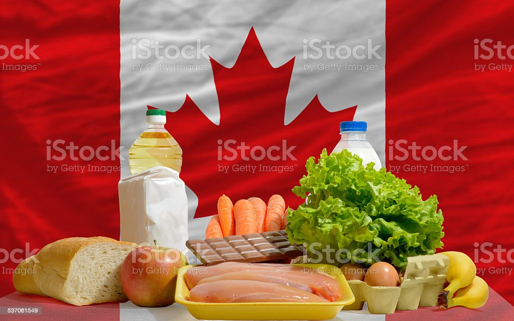 basic food groceries in front of canada national flag stock photo
