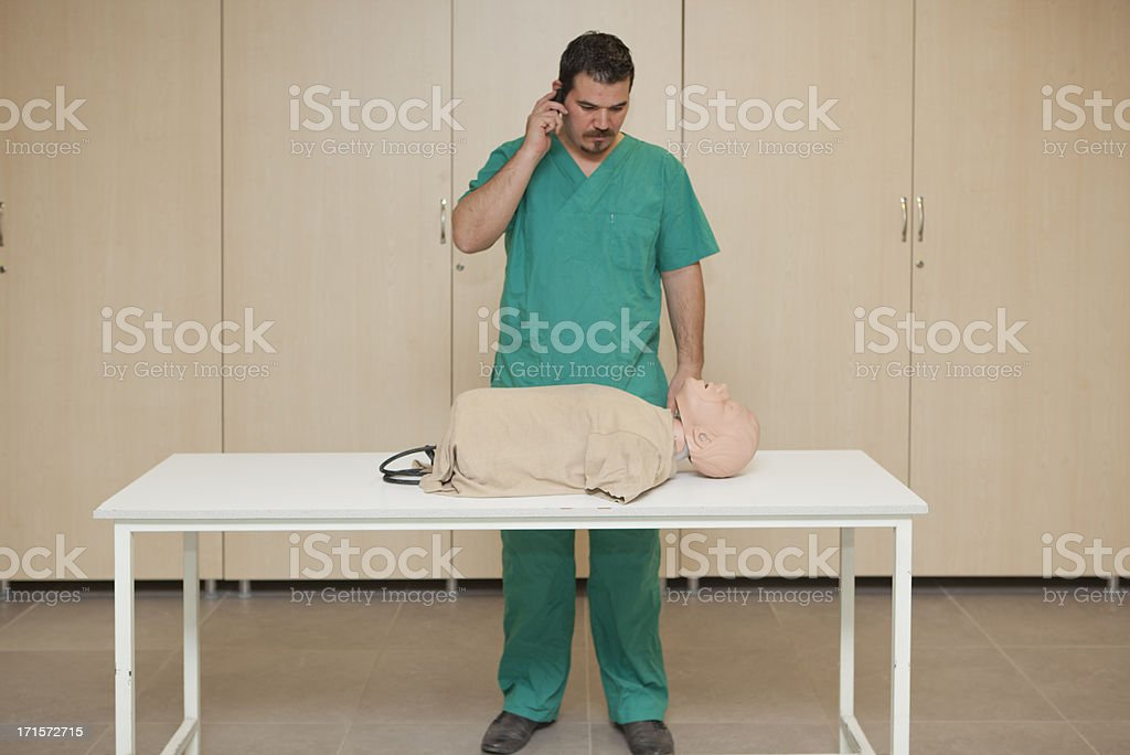 Basic life support training with a CPR Dummy-call first royalty-free stock photo