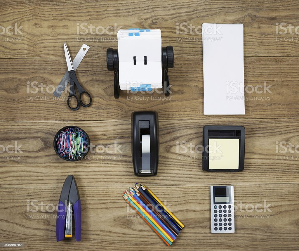 Basic Office Supplies on Aged Wood stock photo