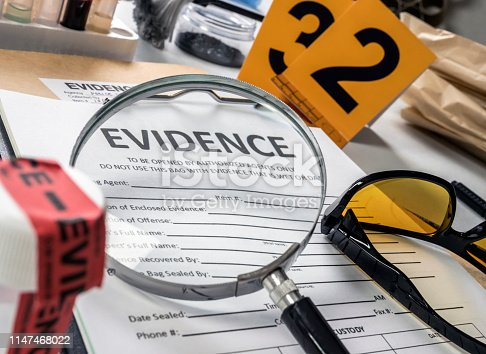 istock Basic research utensils with a evidence bag in Laboratorio forensic equipment, conceptual image 1147468022