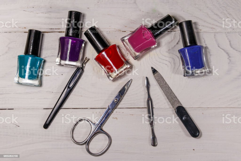 Basic set of manicure tools on white wooden background zbiór zdjęć royalty-free