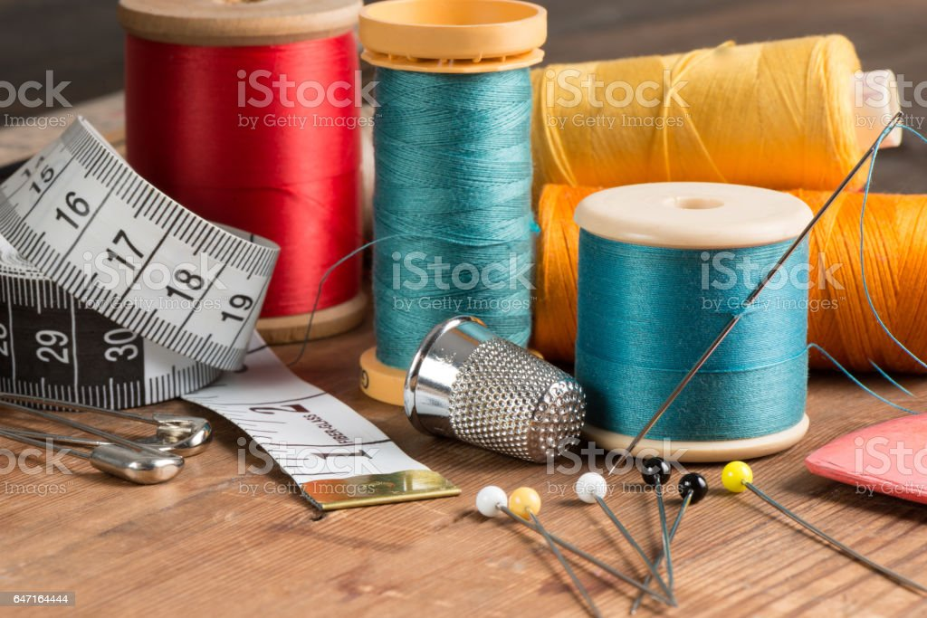 Basic Sewing Tools and Spools of Thread stock photo