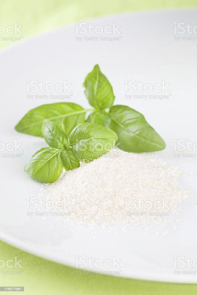 Basil and cane sugar royalty-free stock photo