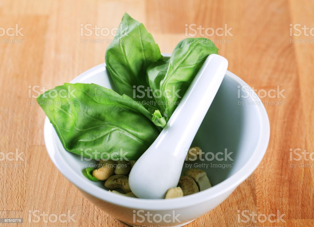 Basil and cashews in a mortar royalty-free stock photo