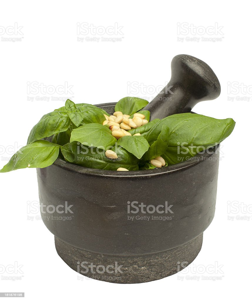 Basil and nuts in a mortar. royalty-free stock photo