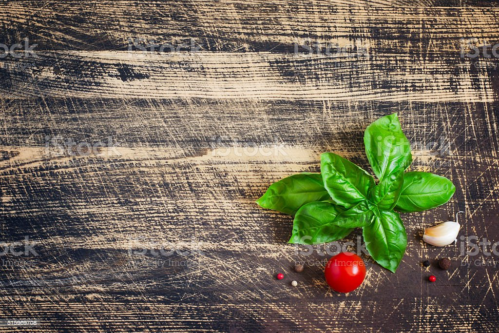 Basil leaves and spices on Shabby wooden background. stock photo
