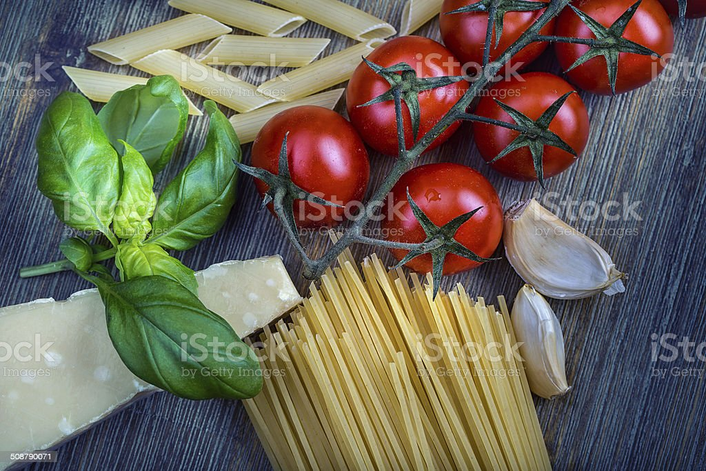 Basil leaves garlic pene,spghetti and cherry tomatoes royalty-free stock photo