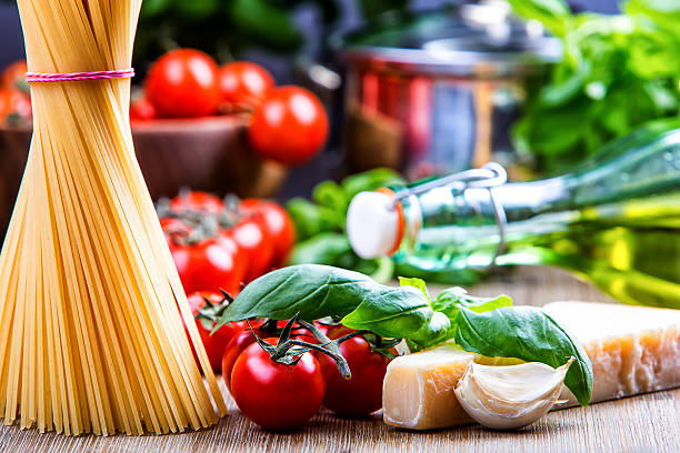 Basil leaves garlic pene,spghetti and cherry tomatoes stock photo