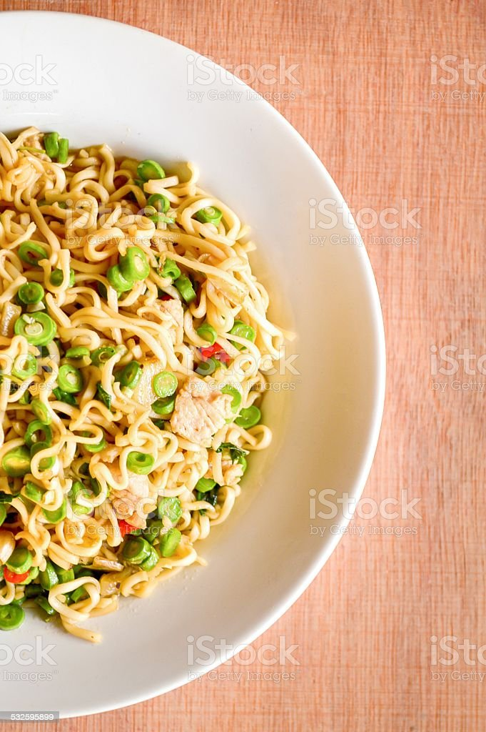 Basil pork fried and noodles stock photo