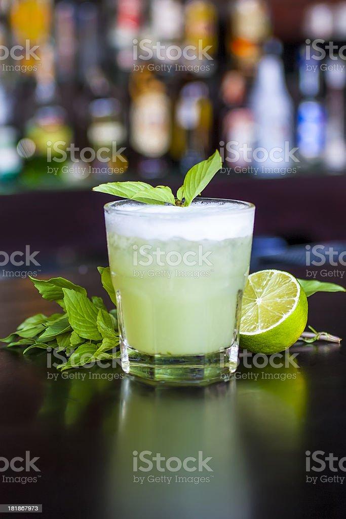 Basil Smash cocktail on the black bar table stock photo