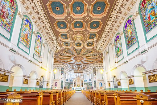 The ornate interior of the Basilica-Cathedral of St. John the Baptist in St. John's, Newfoundland, Canada. It is the metropolitan cathedral of the Roman Catholic Archdiocese of St. John's, Newfoundland.