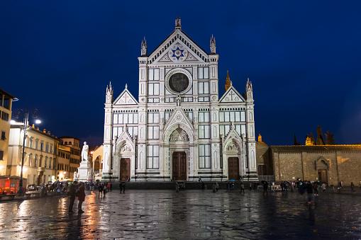 Basilica di Santa Croce on Piazza in rainy night
