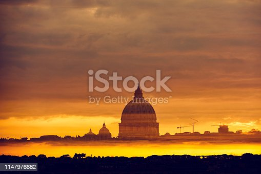 St. Peter's Basilica In Vatican in sunset time, dramatic sky.
