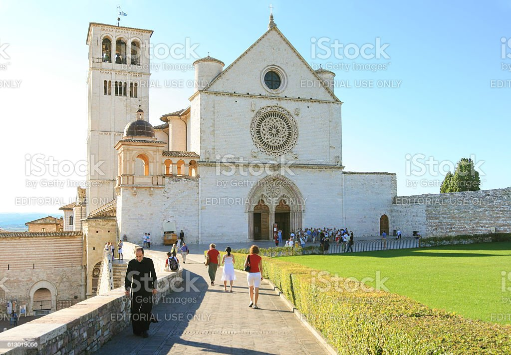 Basilica of Saint Francis of Assisi, Priest, Tourists, Assisi, Italy. stock photo