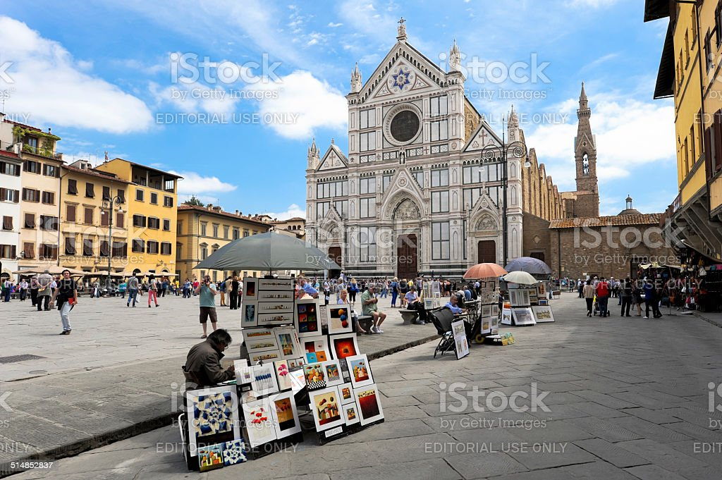 Basilica of Santa Croce in Florence with peddlers stock photo