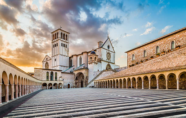 Basilica of St. Francis of Assisi at sunset, Umbria, Italy Famous Basilica of St. Francis of Assisi (Basilica Papale di San Francesco) with Lower Plaza at sunset in Assisi, Umbria, Italy. romanesque stock pictures, royalty-free photos & images
