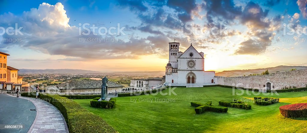 Basilica of St. Francis of Assisi at sunset, Umbria, Italy stock photo