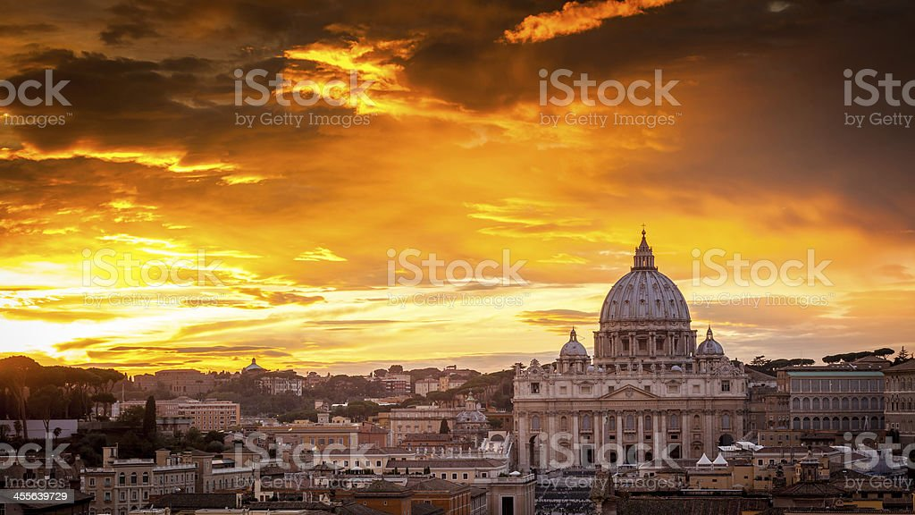 Basilica of St. Peter at sunset in Rome, Italy stock photo
