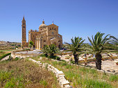 View of The Basilica of the Blessed Virgin of Ta Pinu which is national pilgrim place on island Gozo on Malta. It is located near the village Gharb on the island Gozo in Mediterranean sea, Malta, Europe.