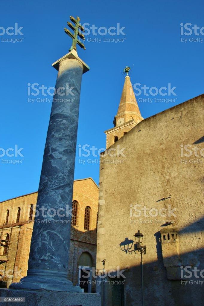 Basilica Santa Eufemia and monument in  Grado, North Italy. stock photo