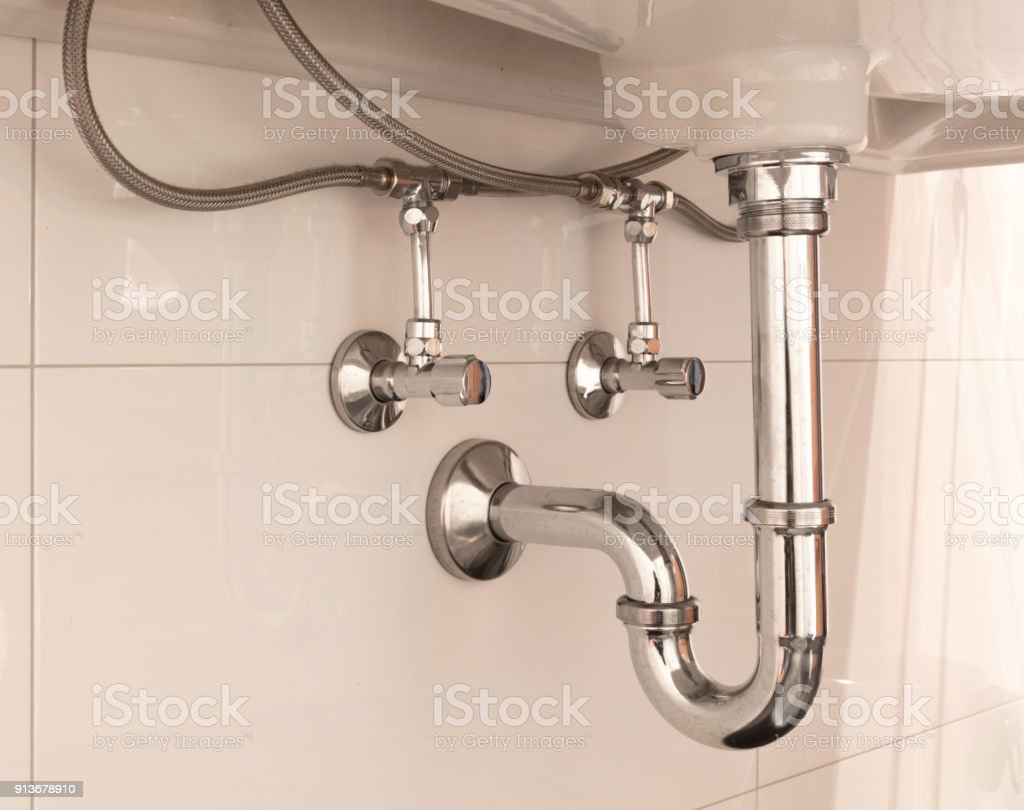 Basin siphon or sink drain in a bathroom stock photo